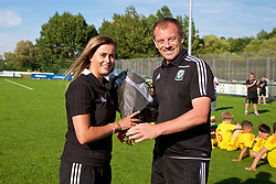 NEWPORT, WALES - Wednesday, July 25, 2018: Head of Player Development Richard Williams presents flowers to Chloe O'Connor after the Welsh Football Trust Cymru Cup 2018 at Dragon Park. (Pic by Paul Greenwood/Propaganda)