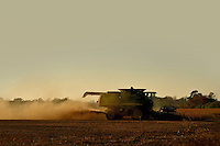 As the sun sets on a warm Fall day, a farmer harvests a soy bean field off Old US 264 in Wilson County near Saratoga.