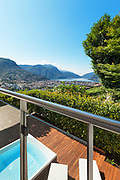 panoramic view from a terrace with jacuzzi, summer day