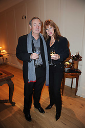 The Ruinart Champagne Christmas drinks party held at Berluti, Conduit Street, London on 9th December 2009.<br /> Picture shows:- NICK & NETTE MASON *** Local Caption *** Image free to use for private use.  If in doubt contact us - info@donfeatures.com