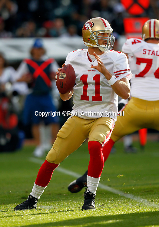 San Francisco 49ers quarterback Alex Smith (11) drops back to pass during the NFL preseason week 3 football game against the Oakland Raiders on Saturday, August 28, 2010 in Oakland, California. The 49ers won the game 28-24. (©Paul Anthony Spinelli)