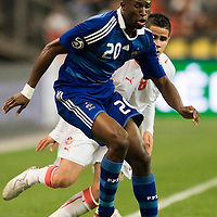 14 October 2008: French defender Rod Fanni #20 vies with Tijani Bel-Aid #8 during the friendly football match won 3-1 by France over Tunisia on October 14, 2008, at the Stade de France in Saint-Denis, near Paris, France.