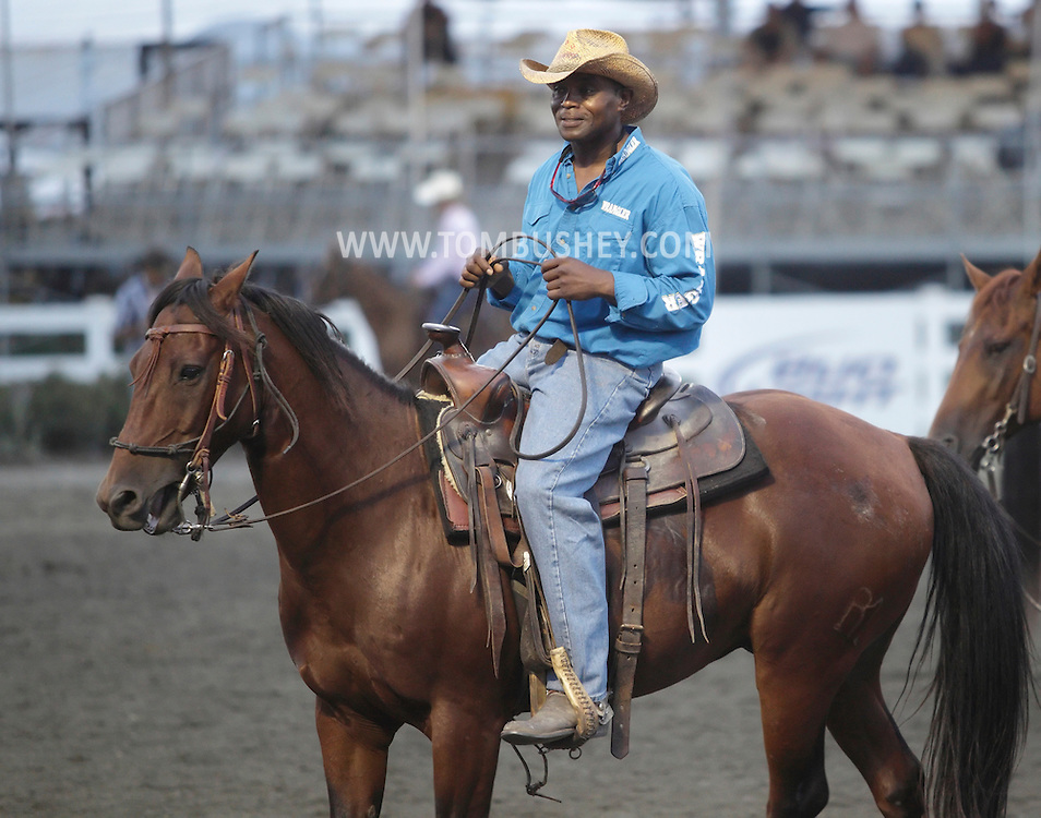 Augusta, New Jersey - A cowboy on his horse waits for his turn in the team penning competition at the New Jersey State Fair and Sussex County Farm and Horse Show on Aug. 11, 2010.