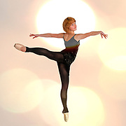 Female Ballet Dancer balances on her tows Digitally enhanced photograph
