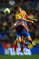 VALENCIA, SPAIN - JANUARY 22:  David Barral (L) of Levante competes for the ball with Carles Puyol of Barcelona during the Copa del Rey Quarter Final First Leg match between Levante UD and FC Barcelona at Ciutat de Valencia on January 22, 2014 in Valencia, Spain.  (Photo by Manuel Queimadelos Alonso/Getty Images)