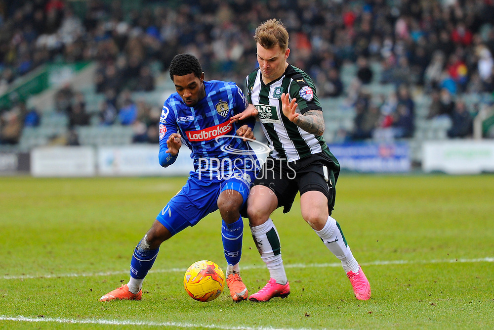 Notts County's Jason Banton and Plymouth Argyle's Gregg Wylde during the Sky Bet League 2 match between Plymouth Argyle and Notts County at Home Park, Plymouth, England on 27 February 2016. Photo by Graham Hunt.