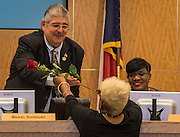 Wretha Thomas presents Manuel Rodriguez a rose during the Houston ISD Board of Trustee meeting, November 10, 2016.