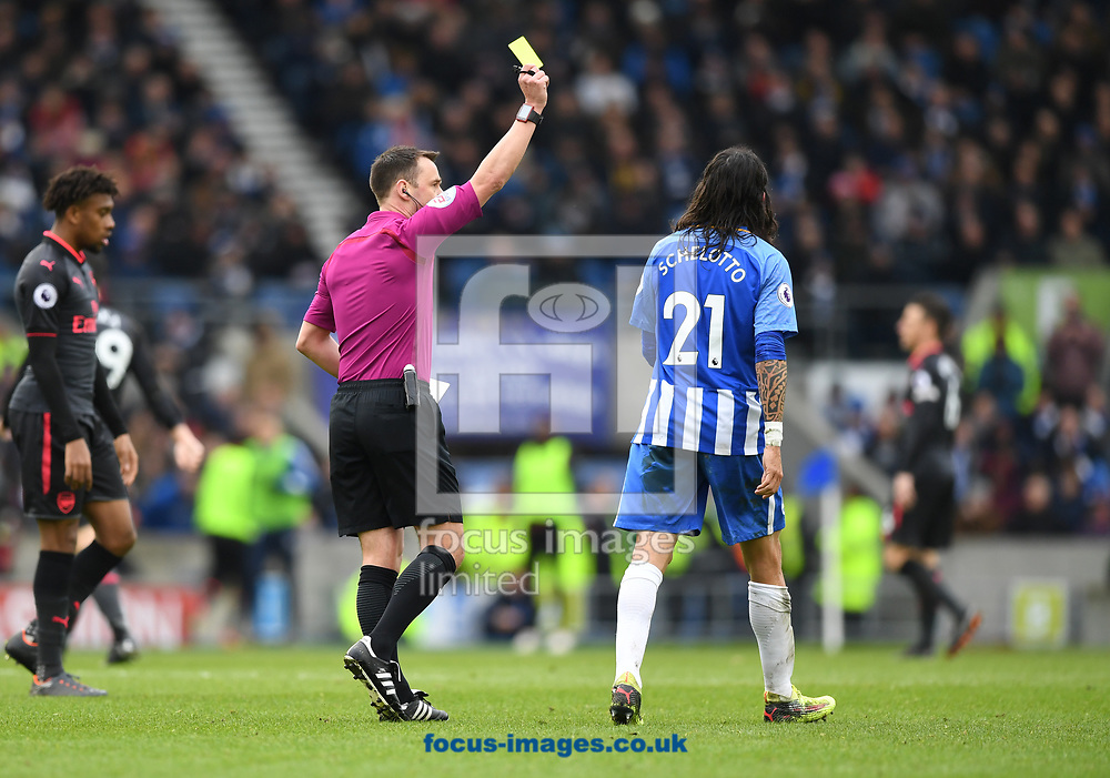 Mati&aacute;s Ezequiel Schelotto of Brighton and Hove Albion is shown a yellow card during the Premier League match at the American Express Community Stadium, Brighton and Hove<br /> Picture by Simon Dael/Focus Images Ltd 07866 555979<br /> 04/03/2018