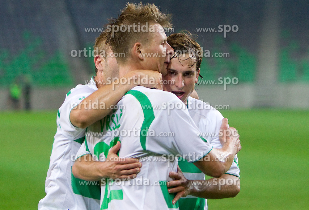 Dare Vrsic and Matic Fink of Olimpija celebrate during friendly football match between NK Olimpija Ljubljana and FC Partizan Beograd (SRB), on June 23, 2011, in SRC Stozice, Ljubljana, Slovenia. (Photo by Vid Ponikvar / Sportida)