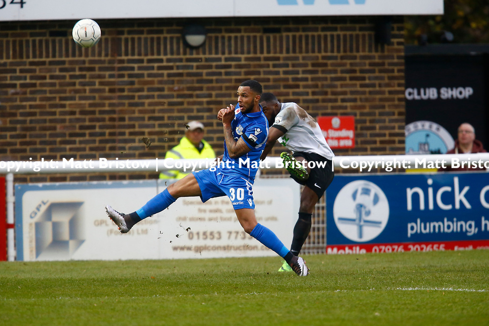 NOVEMBER 11:  Top of the table Dover Athletic host visitors Eastleigh in Conference Premier at Crabble Stadium in Dover, England. Dover ran out emphatic winners 2-0 to remain at the top of the National League. Dover's forward James Alabi crosses the ball past Eastleighs defender Frazer Shaw. (Photo by Matt Bristow/mattbristow.net)