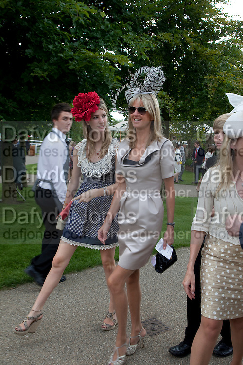 ELLA MAY SANGSTER; FEE SANGSTER;, Glorious Goodwood. Ladies Day. 28 July 2011. <br /> <br />  , -DO NOT ARCHIVE-© Copyright Photograph by Dafydd Jones. 248 Clapham Rd. London SW9 0PZ. Tel 0207 820 0771. www.dafjones.com.