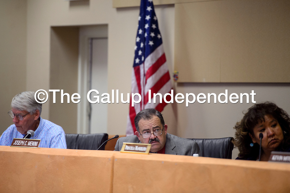 Lynn Huenemann, left, Joseph Menini and Priscilla Manuelito sit on the the Gallup McKinley County board of education at the GMCS Student Support Center in Gallup Monday.
