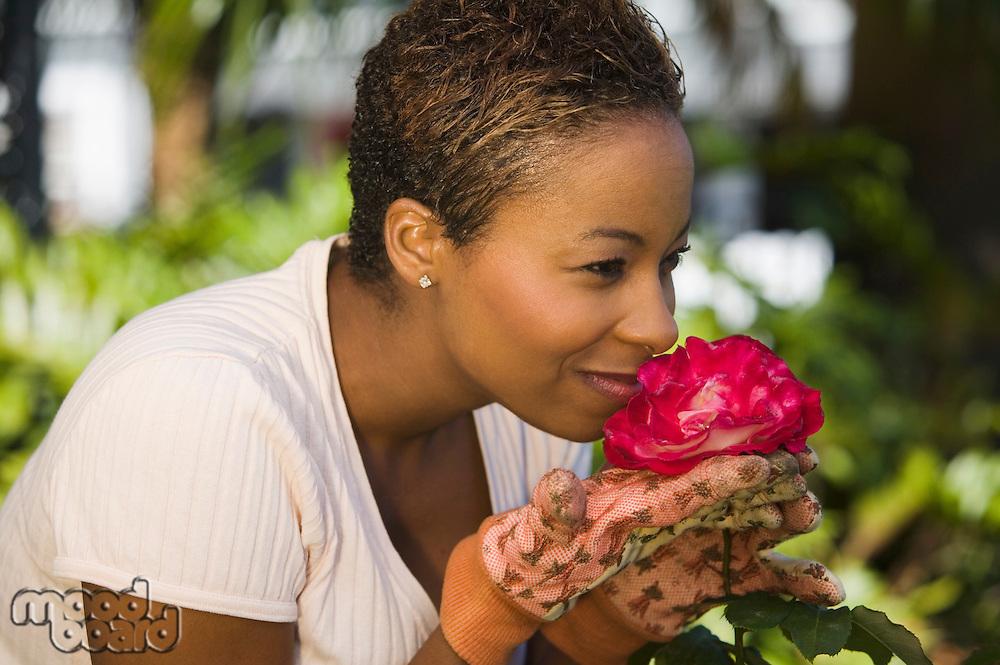 Gardener Smelling a Rose