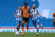 Hull City striker Chuba Akpom goes shoulder to shoulder with Brighton defender Bruno Saltor during the Sky Bet Championship match between Brighton and Hove Albion and Hull City at the American Express Community Stadium, Brighton and Hove, England on 12 September 2015. Photo by Bennett Dean.