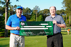 Peach Bowl, Inc. CEO & President Gary Stokan presents Florida head football coach Dan Mullen a check for his charity after the Chick-fil-A Peach Bowl Challenge at the Ritz Carlton Reynolds, Lake Oconee, on Tuesday, April 30, 2019, in Greensboro, GA. (Paul Abell via Abell Images for Chick-fil-A Peach Bowl Challenge)