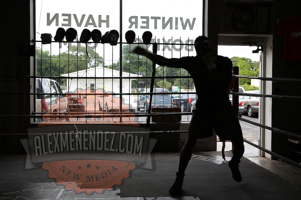 """WINTER HAVEN, FL - MAY 05: Boxer Willie Monroe Jr. shadow boxes during his work out at the Winter Haven Boxing Gym on May 5, 2015 in Winter Haven, Florida. Monroe will challenge middleweight world champion Gennady """"GGG"""" Golovkin for the WBA world championship title in Los Angeles on May 16.  (Photo by Alex Menendez/Getty Images) *** Local Caption *** Willie Monroe Jr."""