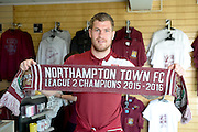 Northampton Town Striker James Collins poses with a champions scarf during the Sky Bet League 2 match between Northampton Town and Crawley Town at Sixfields Stadium, Northampton, England on 19 April 2016. Photo by Dennis Goodwin.