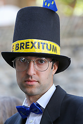 © Licensed to London News Pictures. 04/009/2019. London, UK. A man dressed as Jacob Rees-Mogg protests outside Parliament. On Monday 3 Sept 2019, MP's voted by 328 -301 with a majority of 27 to take control of the House of Commons agenda for Tuesday 4 Sept 2019. Photo credit: Dinendra Haria/LNP