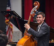 Los Angeles County High School for the Arts Jazz Quartet member Julian Gomez plays bass during a program sponsored by the Thelonius Monk Institute at Waltrip High School, February 29, 2016.
