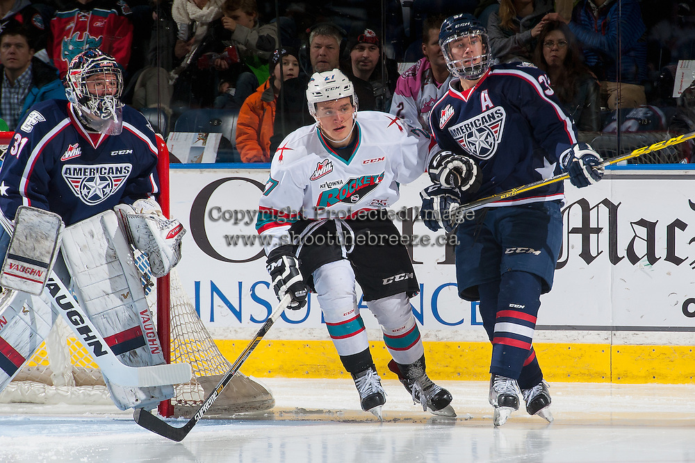 KELOWNA, CANADA - JANUARY 9: Calvin Thurkauf #27 of Kelowna Rockets looks for the pass between Evan Sarthou #31 and Liam Belcourt #27 of Tri City Americans on January 9, 2016 at Prospera Place in Kelowna, British Columbia, Canada.  (Photo by Marissa Baecker/Shoot the Breeze)  *** Local Caption *** Evan Sarthou; Calvin Thurkauf; Parker Wotherspoon;