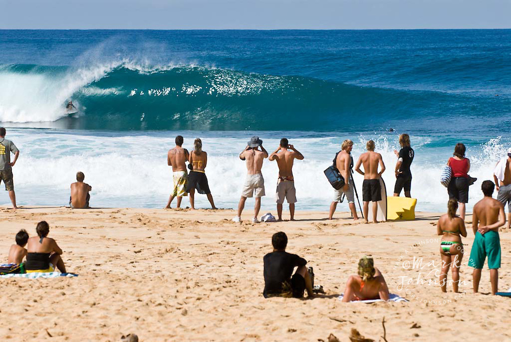Sightseers On Beach Watching The Surfing Action At Pipeline North Shore Oahu Hawaii
