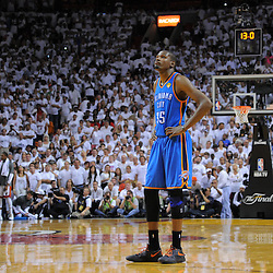 Jun 17, 2012; Miam, FL, USA; Oklahoma City Thunder small forward Kevin Durant (35) reacts with 13 seconds left iduring the fourth quarter in game three in the 2012 NBA Finals against the Miami Heat at the American Airlines Arena. Miami won 91-85. Mandatory Credit: Derick E. Hingle-USA TODAY SPORTS