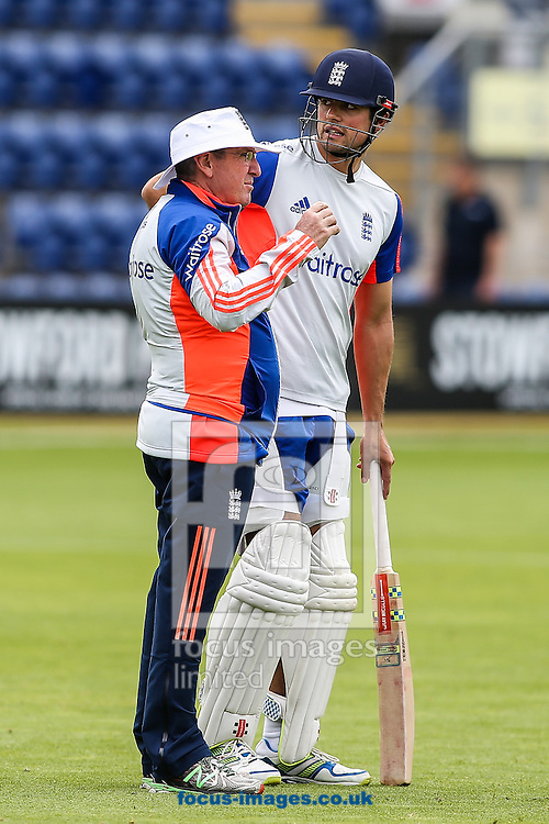England head coach Trevor Bayliss (left)  with England captain Alistair Cook (right) during the England Cricket Practice before the first Test Match of the Investec Ashes Series at Sophia Gardens, Cardiff<br /> Picture by Andy Kearns/Focus Images Ltd 0781 864 4264<br /> 07/07/2015