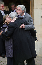 © Licensed to London News Pictures. 07/10/2014London, UK. Pualine Collins and John Alderton hug actor Tom Conti at the funeral of singer Lynsey de Paul in Hendon, North London Photo credit : Simon Jacobs/LNP