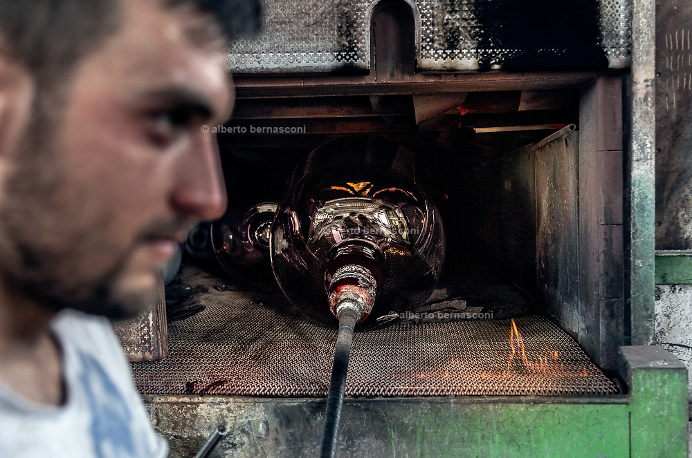 Italy, Veneto, Piombino Dese: New Group Glass Vetreria, working for Pulpo designers, once tha glass has reached the desired shape, it's placed in another oven for hours in order to cool slowly down.