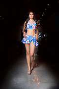 Houston model Elodi Tusac walks runway in blue printed two-piece for Houston Fashion Week.