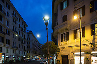 ROME, ITALY - 20 MARCH 2017: (L-R) White light LED lampposts and a yellow light sodium lamppost are seen here in the Coppedè neighborhood in Rome, Italy, on March 20th 2017.<br /> <br /> Rome is undergoing a city-wide plan to change its public illumination from the current yellow sodium street lights CK to white LED lamps. In making the change, Rome joins a long line of cities around the world that have switched to the cheaper, and more environmentally friendly LED lighting, and it is not the first city where that change has come at the price of protest.<br /> <br /> Since July, some 100,000 led lights have already been installed, just over half the number that will be substituted in the 53 million euro changeover that is expected to save the city millions of euros in electrical bills. But when Rome's municipal electrical utility ACEA began to substitute the lamps in Rome's historic center, residents began to take note.