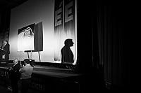"""Palermo, Italy, 25 October 2012: Canidate for Governor of Sicily Gianfranco Micciché, 58, rallies at his electoral committee  in Palermo, on October 25 2012. His motto is """"Sugnu Sicilianu - Sogno Siciliano"""", which translates as """"I am Sicilian"""" in the Sicilian dialect and """"Sicilian dream"""". His is allied with the MpA (Movimento per le Autonomie, Movement for Autonomies), a regionalist and Christian democratic party which demands greater autonomy for Sicily. The movement was founded my former Governor of Sicily Raffaele Lombardo, who resigned in July. Gianfranco Micciché is endorsed by President of the Chamber of Deputies and leader of the Future and Freedom party Gianfranco Fini.<br /> <br /> The direct elections in Sicily for the President of the Region and its representatives will take place on Sunday 28 October 2012, 6 months ahead of the end of the terms of office of the current legislature. The anticipated election of October 28 take place after Raffaele Lombardo, former governor of Sicily since 2008, resigned on July 31st. Raffaele Lombardo is under investigation since 2010 for Mafia ties. His son Toti Lombardo is currently running for a seat in the Sicilian Regional Assembly in the coalition of Gianfranco Micciché, a candidate for the Presidency of the Region. 32 candidates belonging to 8 of the 20 parties running for the Sicilian elections are either under investigation or condemned. ### Palermo, Italia, 25 ottobre 2012: il candidato alla Presidenza della Regione Gianfranco Micciché, 58 anni, fa un comizio nel suo comitato elettorale a Palermo il 25 ottobre 2012. Il suo slogan è """"Sugnu Siciliano - Sono Siciliano"""" (""""Sono siciliano in dialetto). Si è alleato con l'Mpa (Movimento per le Autonomie), fondato da Raffaele Lombardo, il quale ha rassegnato le dimissioni a luglio. Gianfranco Micciché è appoggiato dal Presidente della Camera dei Deputati e leader di Futuro e Libertà Gianfranco FIni.<br /> <br /> Le elezioni in Sicilia per la votazione diretta del preside"""