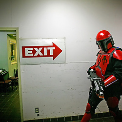 Kyle Green | The Roanoke Times<br /> March 01, 2009 - John Feldbusch, from Fredricksburg, Virginia, and a member of The Mandalorian Mercs, patrols a kitchen hallway of the Holiday Inn in Roanoke, Virginia during the 17th annual SheVaCon science fiction and fantasy convention. The Mandalorian Mercs Costume Club is a Star Wars related Mandalorian Costume organization. The 200 member Mandalorain Mercs have 18 chapters in 6 countries around the world.