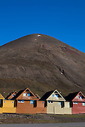 Colourful spisshus timber houses in Longyearbyen, Svalbard. Constructed for coal mining company Store Norske in the 1970s by construction firm Moelven Bruk, with colours chosen by Grete Smedal, professor of art and design in Bergen. The northernmost settlement with more than 1,000 people on earth, and is quite well-serviced town, with an airport and university and hospital, just 1300km from the North Pole
