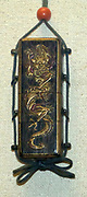 Inro- Lacquer on wood veneer; dragon; Kan seal; circa 1700-1800 Coral bead.