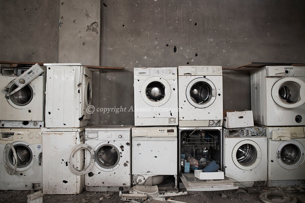 Gaza Strip, Gaza City: Demaged by shrapnel washing machines are  seen in a storehouse in Shujayeh neighbourhood during a 72 hours ceasefire on August 11, 2012. ALESSIO ROMENZI