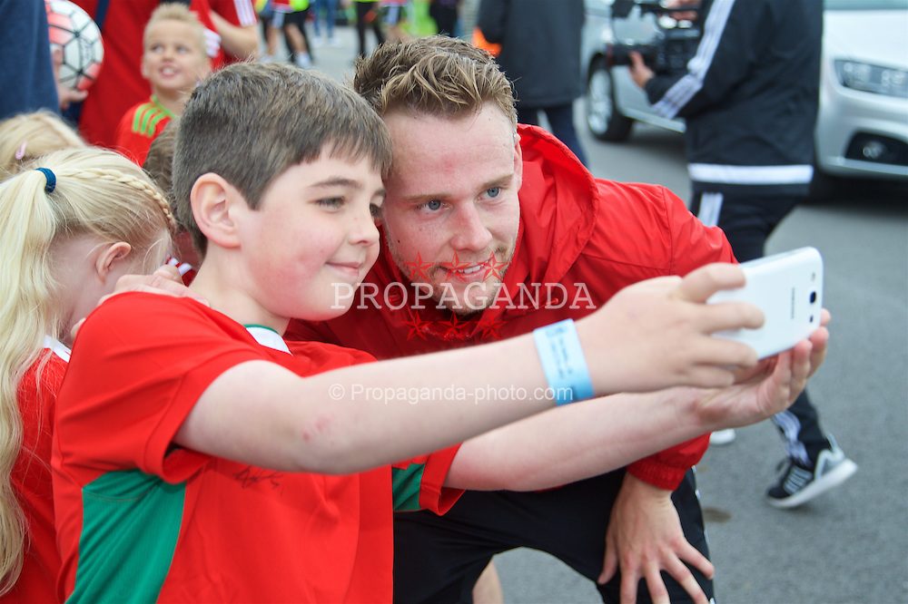 CARDIFF, WALES - Wednesday, June 1, 2016: Wales' Chris Gunter has a photo taken with a supporter after a training session at the Vale Resort Hotel ahead of the International Friendly match against Sweden. (Pic by David Rawcliffe/Propaganda)