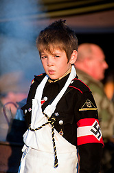 A young reenactor dressed as a member of the Nazi Hitler Youth<br />