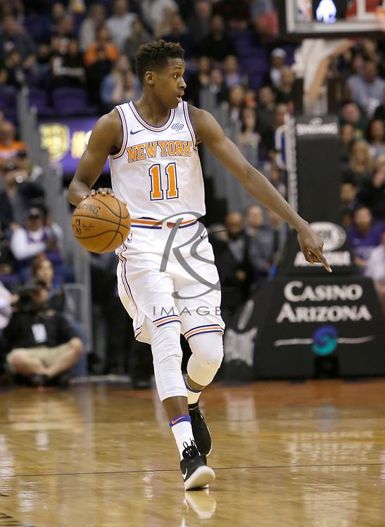 New York Knicks guard Frank Ntilikina (11) in the first half during an NBA basketball game against the Phoenix Suns, Friday, Jan. 26, 2018, in Phoenix. (AP Photo/Rick Scuteri)