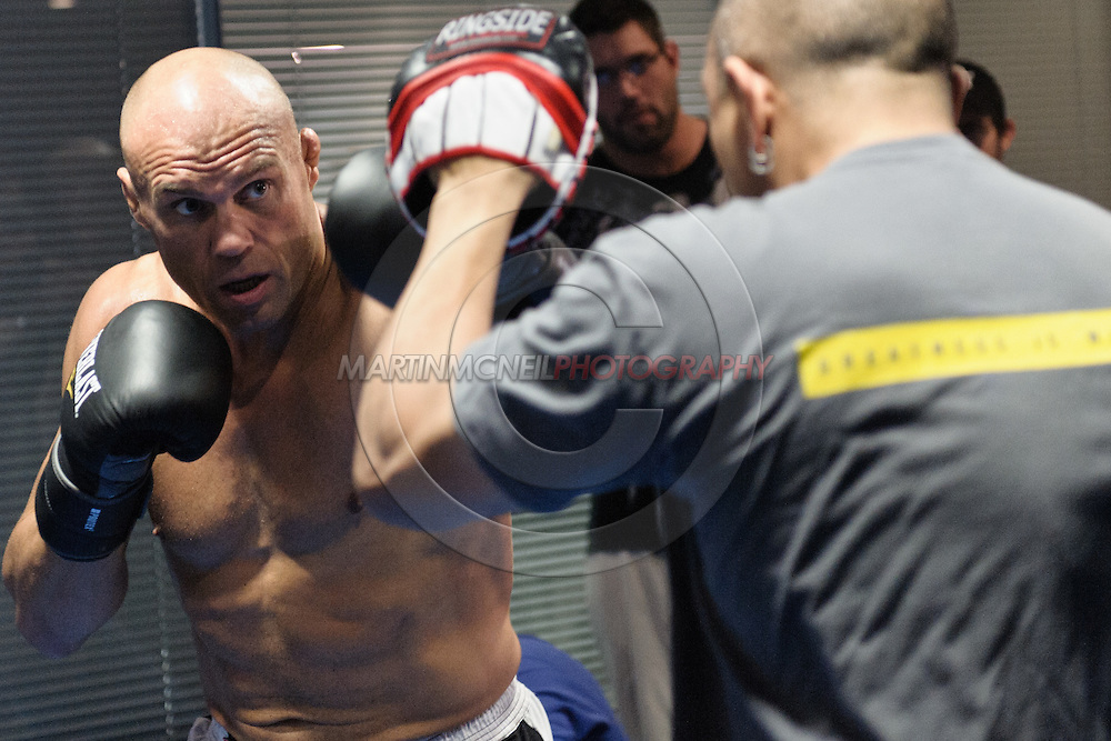 MANCHESTER, ENGLAND, NOVEMBER 11, 2009: Randy Couture (left) performs focus mitt striking drills during the open work-outs for UFC 105 at the Crowne Plaza Hotel in Manchester, England on November 11, 2009.