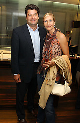 TANIA BRYER and her husband TIM MOUFARRIGE at a party to celebrate the publication of 'The Russian House' by Ella Krasner held at De Beers, 50 Old Bond Street, London W1 on 9th June 2005.<br />