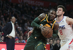 January 16, 2019 - Los Angeles, California, United States of America - Danilo Gallinari #8 of the Los Angeles Clippers tries to block a drive by Royce O'Neale #23 of the Utah Jazz during their NBA game  on Wednesday January 16, 2019 at the Staples Center in Los Angeles, California. Clippers lose to Jazz, 129-109. JAVIER ROJAS/PI (Credit Image: © Prensa Internacional via ZUMA Wire)