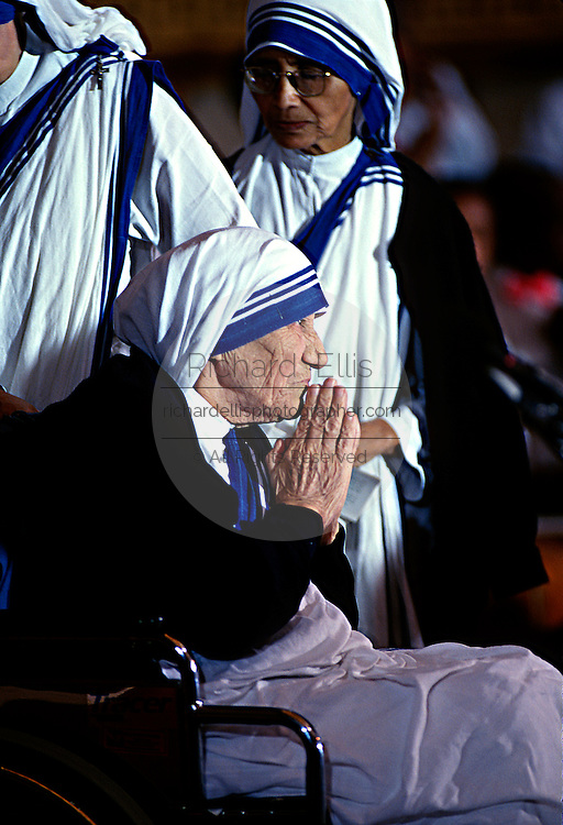 Mother Teresa, founder of the Missions of Charity order receives holds her hands together in greeting after she received the Congressional Medal of Honor during a ceremony in the U.S. Capitol May 6, 1997 in Washington, DC.