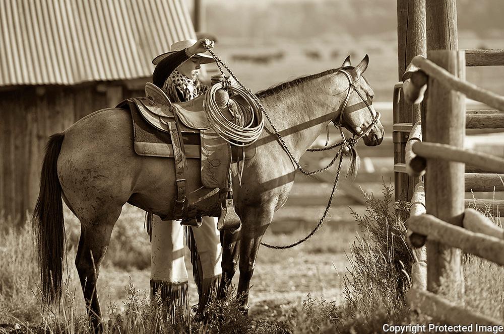 Cowgirl Saddling Horse