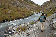 Hiker walking along the Savage River, Denali National Park, Alaska