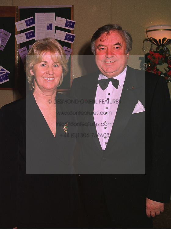 MR & MRS JIMMY TARBUCK he is the comic, at a ball in London on 17th December 1997.MEG 21