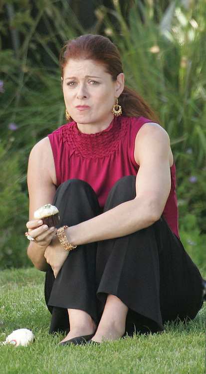 Los Angeles, CA. Monday July 1st 2008  Non Exclusive Photo. Debra Messing is comforted by actress Judy Davis and a cupcake while filming a scene for 'The Starter Wife'.  Photograph: On Location News. Sales: Eric Ford 1/818-613-3955 info@OnLocationNews.com