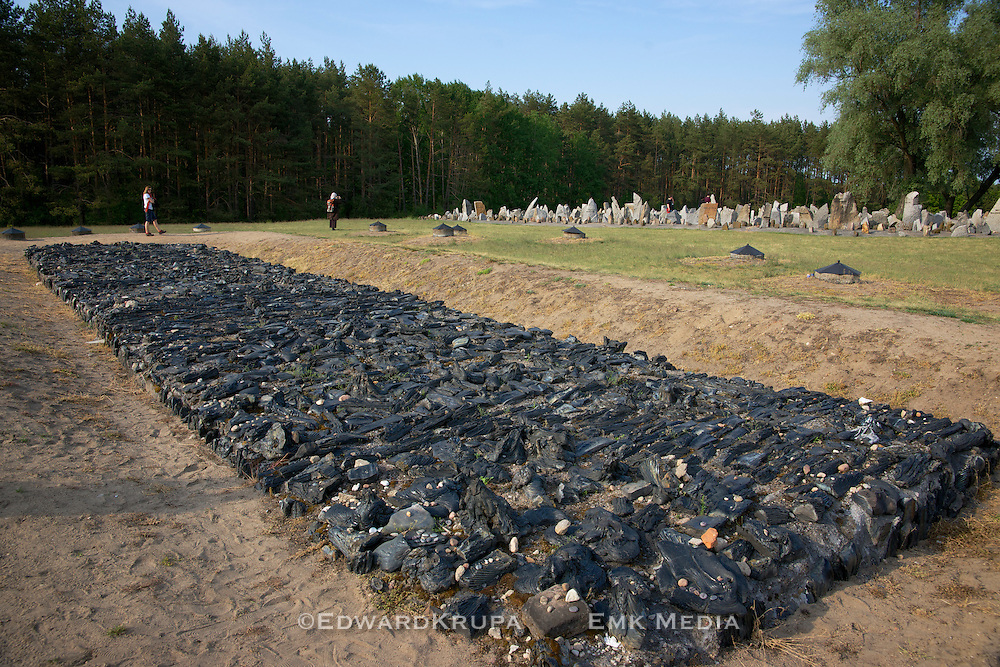 Burning pit memorial..Blackened mass of basalt marks the location of pits in which bodies were burned in the World War 2 Nazi death camp of Treblinca.