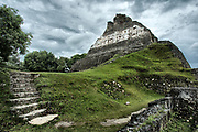"""Xunantunich, is a Maya term meaning """"stone woman"""". The largest structure is El Castillo which rises 130 feet from the Plaza floor, and is covered in elaborately carved friezes. Xunantunich, Belize."""