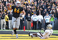 November 10 2012: Iowa Hawkeyes tight end C.J. Fiedorowicz (86) celebrates after a 5 yard touchdown reception as Purdue Boilermakers defensive back Taylor Richards (4) looks on during the NCAA football game between the Purdue Boilermakers and the Iowa Hawkeyes at Kinnick Stadium in Iowa City, Iowa on Saturday, November 10, 2012. Purdue defeated Iowa 27-24.